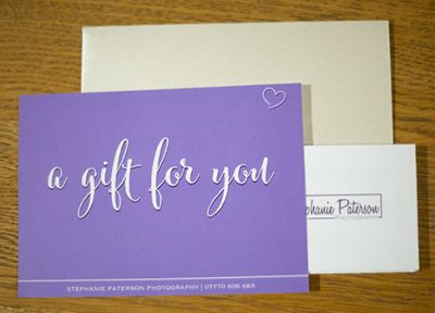 Purple Gift voucher on wooden background